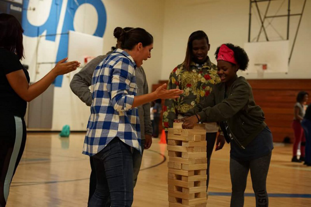 Youth play a giant game of Jenga at a SuperSize Me event.