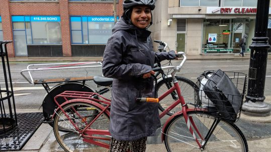 Woman getting to work by bike.
